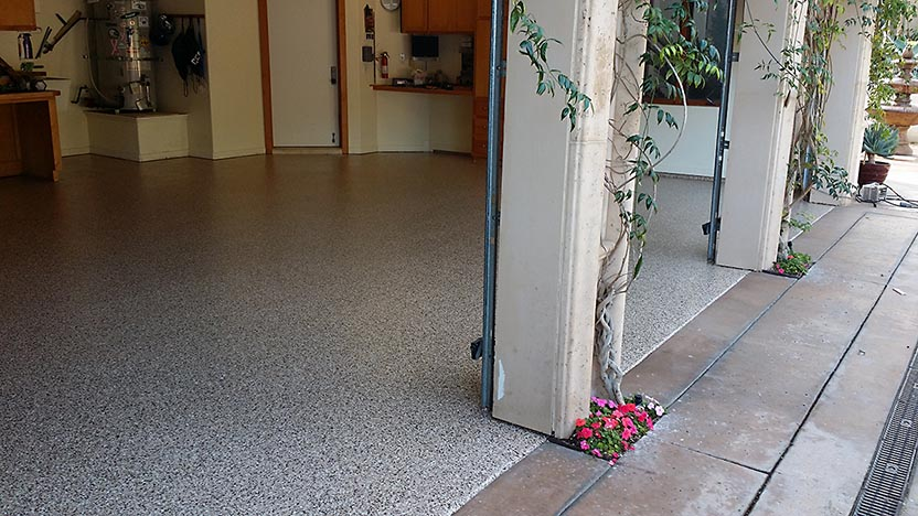 Photo of a floor after a Roll on Rock epoxy finish is applied