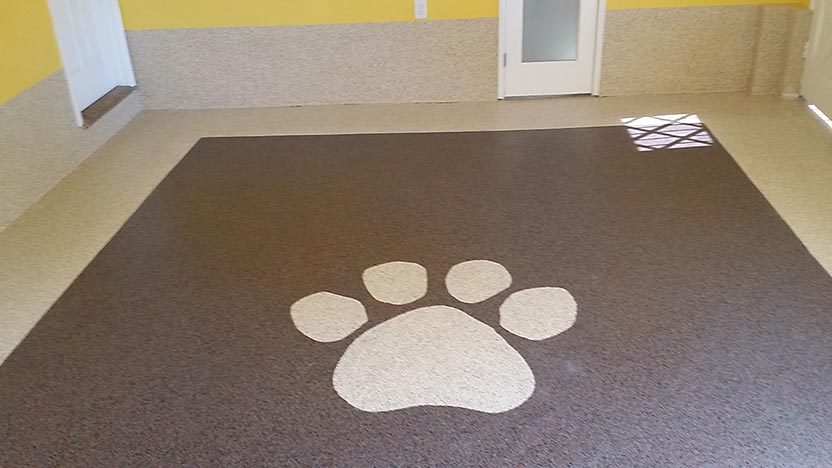 Image of custom epoxy floor with paw icon
