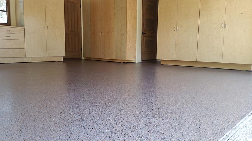 Photo of a floor with a pink Roll on Rock epoxy finish